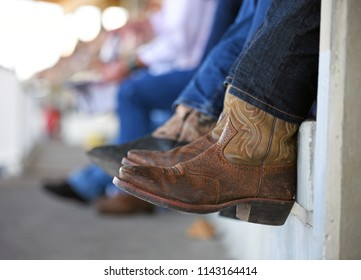 Cowboy boots over edge