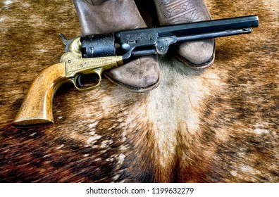 Cowboy boots and western cowboy pistol.