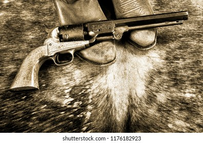 Cowboy boots and western cowboy pistol in black and white.