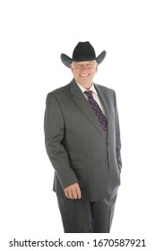 Cowboy. A business man wears a black cowboy hat and his suit. A friendly cowboy business man wants to make a deal with you. Isolated on white. Room for text. Clipping Path. Happy man makes a deal.