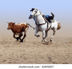 Cowboy Coming off his Horse after a Steer with clipping path
