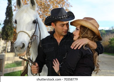 Cowboy and Cowgirl Couple with their White horse