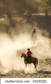 Cowboy and Cowgirl in early morning light