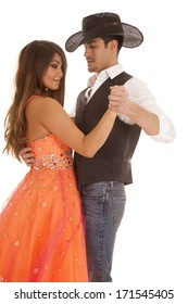 a cowboy dancing around with his beautiful woman in her dress.