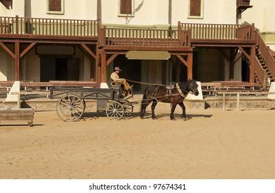Cowboy driving a wagon at Mini Hollywood, Tabernas, Almeria Province, Andalusia, Spain