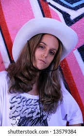 cowboy fashion girl in graffiti background