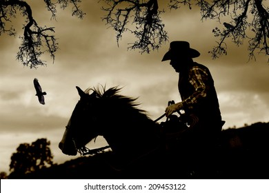 A cowboy gallops down a hill to escape danger.  Sepia tone, black branches, and birds.