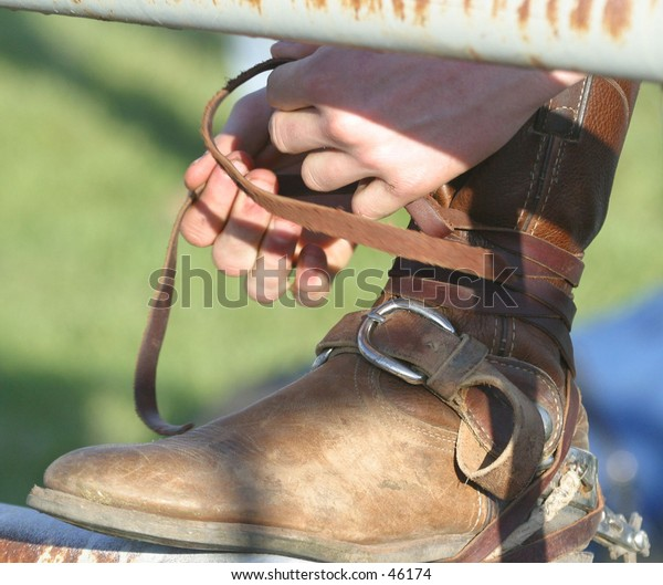 a cowboy gears up to compete in a rodeo