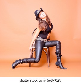 Cowboy girl wearing leather pants