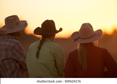 cowboy and girls in the sunset at a Gymkhana