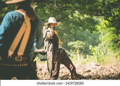 cowboy with gun prepares to gunfight.