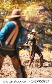 Cowboy with gun prepares to gunfight