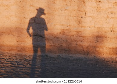 Cowboy gunslinger in the duel with his shadow