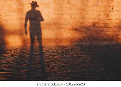 Cowboy, gunslinger getting ready for a duel. Silhouette of gunslinger