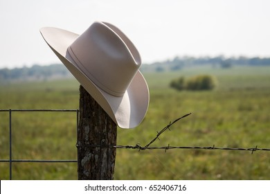 Cowboy Hat Alone on Fence