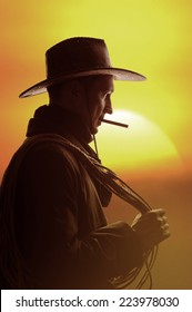 cowboy in hat with cigar and lasso silhouette