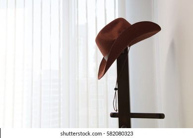 ea0169d5668 cowboy hat hang on hanging hat with curtain background