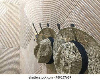 9835d5c37e8 cowboy hat hanging on an old wooden wall
