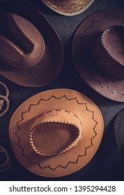 cowboy hat at table wooden background, top view
