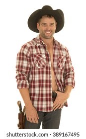a cowboy in his plaid shirt with a smile, wearing his western hat with a pistol on his hip.