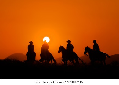 Cowboy with horse Wild West sunset landscape background, sihouette
