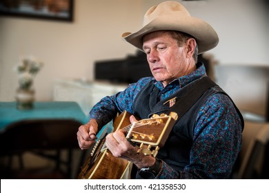 Cowboy playing western guitar