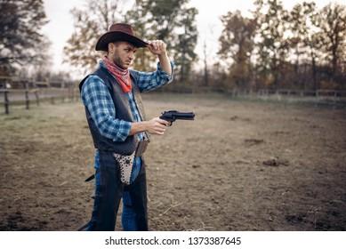 Cowboy with revolver, gunfight on ranch, western
