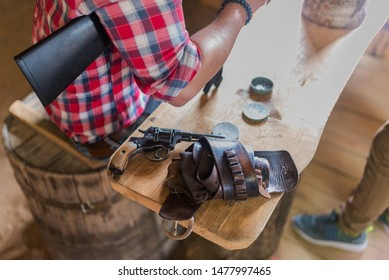Cowboy revolver holster on table
