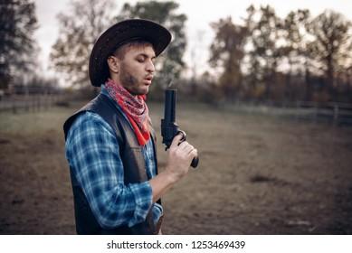 Cowboy with revolver wins gunfight, lucky strike