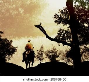 A cowboy rides his horse into the mountains.