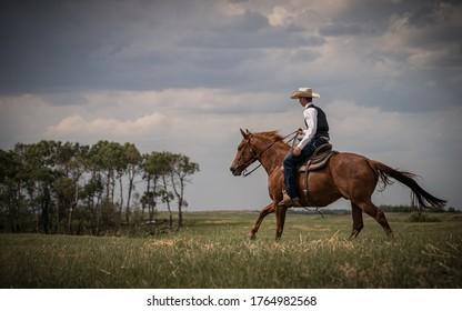 Cowboy Riding Across the Prairies on his Horse