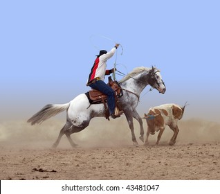 Cowboy Roping a Steer isolated with clipping path