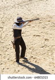Cowboy Sheriff shooting his rifle