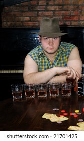 The cowboy suggests to drink and play in cards