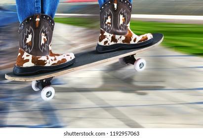 Cowboy surfer on a street skateboard.