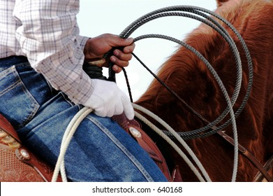 A cowboy waits to compete in the roping competition.