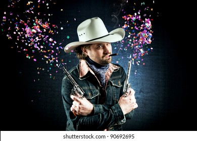 Cowboy in white hat shooting confetti out of two toy guns