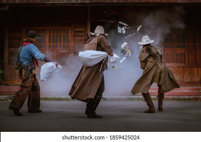 Cowboys group showing action success bank rob with fighting gun and a lot of  money from rob the bank with white smoke vintage style background.