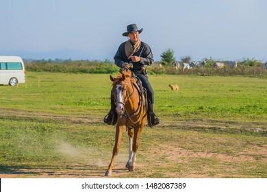 Cowboys on horseback.Cowboys riding horse.