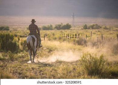 Cowboys riding a horse over the mountains