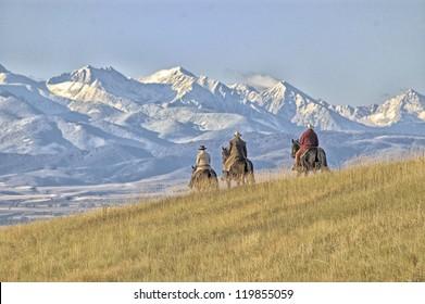 Cowboys riding the range, Montana horse ranch