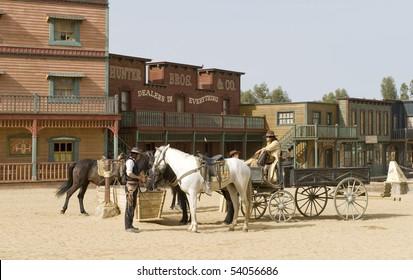 Cowboys watering their horses