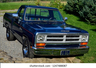 Cowen, West Virginia, USA, 1989 classic Dodge Ram 100, with 318 cubic inch engine,  throttle body fuel injection for more horsepower, Twilight Blue Metallic paint color, July 22, 2015