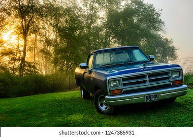 Cowen, West Virginia, USA, Dripping with dew, a 1989 classic Dodge Ram 100, with 318 cubic inch engine, throttle body fuel injection for more horsepower, Twilight Blue Metallic paint color, May 24, 20