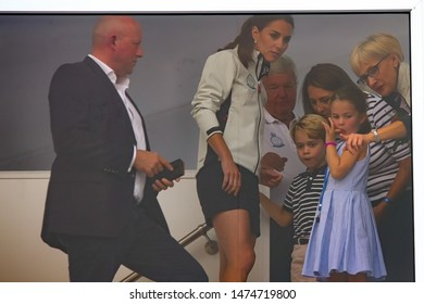 COWES, ENGLAND. 08 AUGUST 2019: Catherine, Duchess of Cambridge looks on with Prince George and Princess Charlotte, during the SailGP race weekend held in Cowes, Isles of Wight, UK.