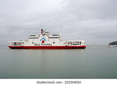 COWES, ISLE OF WIGHT, UK - 22 OCT, 2014:  Isle of Wight ferry, Red Falcon, entering Cowes Harbour after crossing from Southampton.