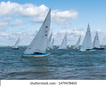 Cowes, Isle of Wight / United Kingdom - August 15 2019: White Sailing Boats Compete At Cowes Week 2019 Sailing Regatta On The Solent, Isle of Wight