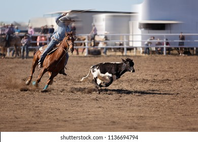 Cowgirl in calf roping event at a country rodeo in Australia