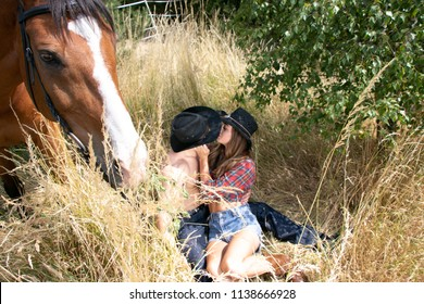 Cowgirl and cowboy country and western man and woman with horse and saddle on farm, ranch