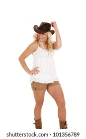 A cowgirl having some fun dancing around with a smile on her face.
